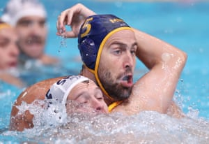 Nikola Jaksic of Serbia (left) and Montenegro's Uros Cuckovic in action during the men's water polo.