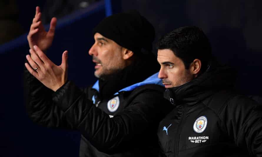Mikel Arteta a week before he became Arsenal manager, with Pep Guardiola during Manchester City's Carabao Cup quarter-final at Oxford