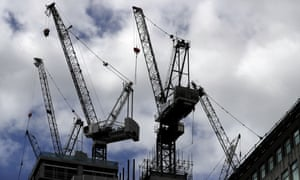 Construction cranes in London.