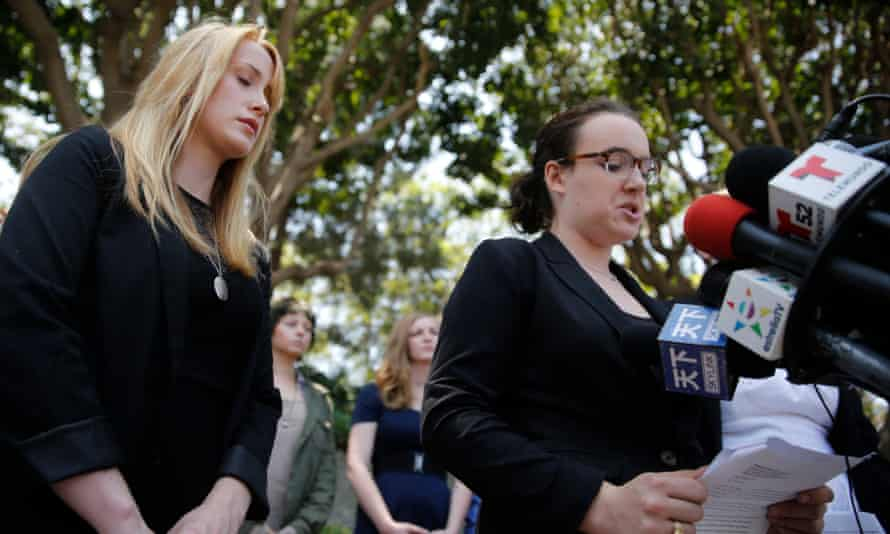 Survivor Tucker Reed, left, closes her eyes in 2013 as she listens to Ari Mostov tearfully reveal details of her sexual assault.