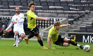 Will Grigg (L) scores for MK Dons.