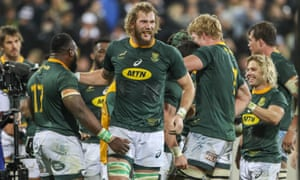 The Springboks celebrate after their stunning 36-34 win over the All Blacks in Wellington.