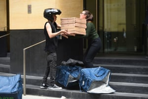 A staff member receiving a pizza delivery at the London office of Deutsche Bank