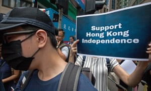 Pro-Hong Kong independence supporters gather during a protest.