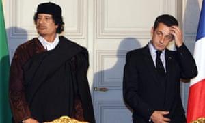 Nicolas Sarkozy and the former Libyan leader Muammar Gaddafi pictured in 2007