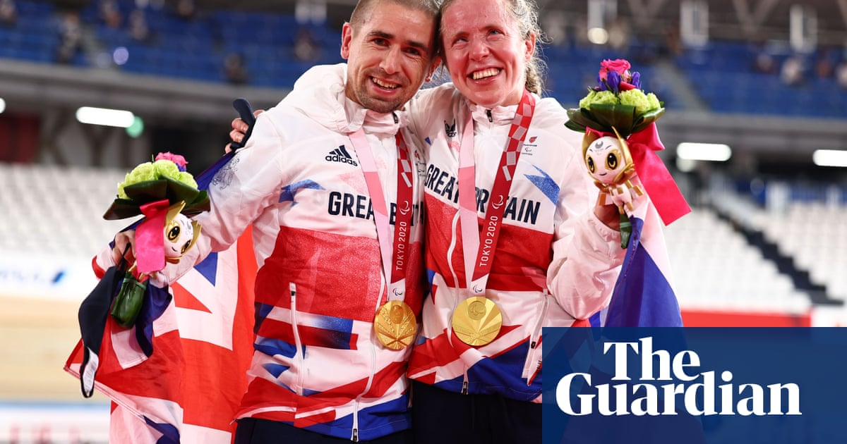 Husband and wife Neil and Lora Fachie each win cycling gold at Paralympics