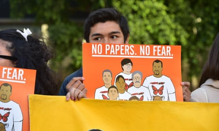 Supporters of undocumented Romulo Avelia-Gonzalez, who was arrested by ICE agents last week, attend a rally in downtown Los Angeles.
