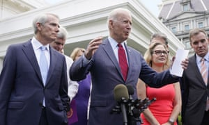 Biden with the group of senators on Thursday. He said the group had 'come together and forged an infrastructure agreement that will create millions of American jobs.'