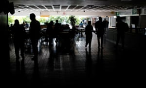 People at a shopping mall during a blackout in Caracas, Venezuela, on Thursday.