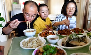 Hao Tiedan has dinner with his family at home in Taiyuan, China. Tiedan left in February as a member of a medical team to fight coronavirus and returned home after 67 days.