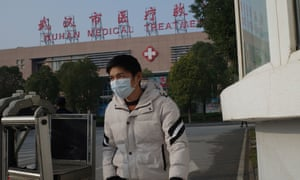 A man leaves the Wuhan Medical Treatment Centre