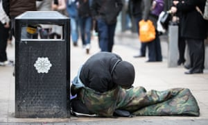 Homeless man slouched in sleeping bag