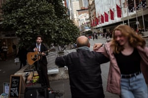 Melbourne busker Aaron Pollock entertains passersby in Bourke St Mall during his Saturday performance.