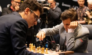 Magnus Carlsen, right, does battle with Fabiano Caruana at the world chess championship in London.
