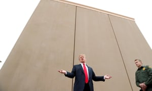 Donald Trump stands by US-Mexico border wall prototypes near San Diego, California. Congress approved no funds for these designs to be built in its latest budget.