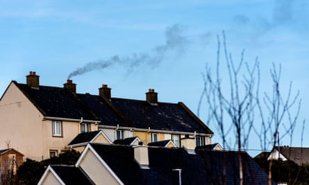 Smoke from burning of fossil fuel blows into the sky in Ardara, County Donegal, Ireland.