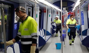 Workers clean a train to help prevent the spread of coronavirus in Madrid, Spain.