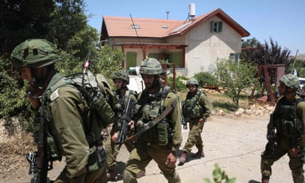 Israeli soldiers outside the house where the girl was killed