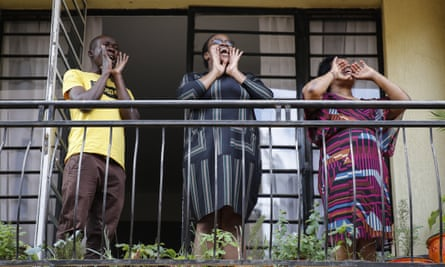 Residents sing from their apartment balcony