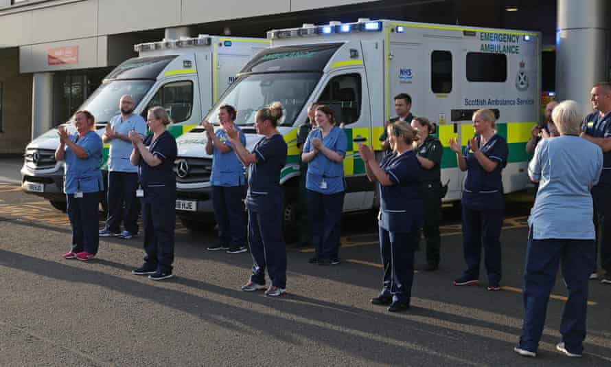 Staff from Queen Elizabeth university hospital in Glasgow gather to clap on Thursday 28 May 2020.