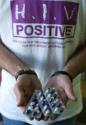 A South African Aids activist holds capsules of a generic medicine.