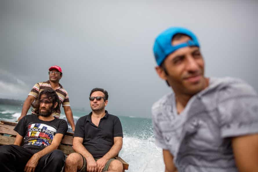 Behrouz Boochani, (front left ) and Ari Sirwan (foreground), on a trip to a neighbouring island for a swim.