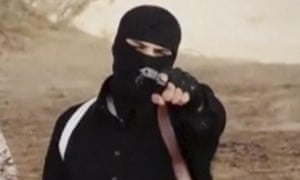 An Islamic State militant holds a gun in a still from the latest Isis video.