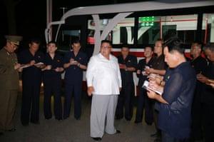 Kim visits the Pyongyang Trolley Bus Factory and the Bus Repair Factory in Pyongyang, North Korea.