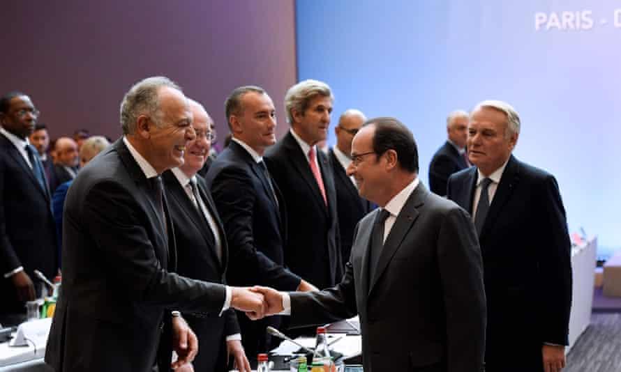 The French president, François Hollande, greets the Moroccan foreign minister, Salaheddine Mezouar