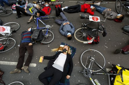 Protesters stage a die-in protest at an anti-pollution rally outside the Department for Transport in London, 27 April, 2016.