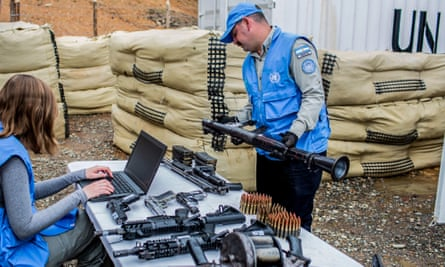 UN observers check weapons handed by the Farc as part of the peace process.