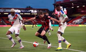 Bournemouth's Jack Stacey battles for the ball with Crystal Palace's Patrick van Aanholt (left)l and Wilfried Zaha.