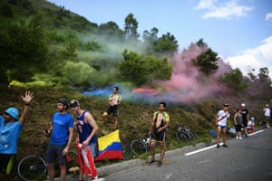 Cycling enthusiasts wait for riders during the fourteenth stage of the Tour de France between Tarbes and Tourmalet Bareges.