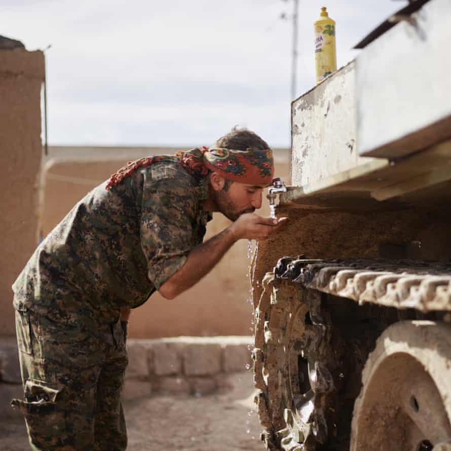 A YPG fighter takes a break during an operation to get a drink of water. Tel Tamir, Jazira canton, Rojava, in Syria, on 7 March 2015.