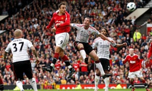 Dimitar Berbatov outjumps Jamie Carragher to complete his hat-trick against Liverpool in 2010.