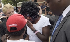 Gloria Darden wipes away tears after prosecutors dropped remaining charges against the three Baltimore police officers who were awaiting trial over her son Freddie Gray's death.
