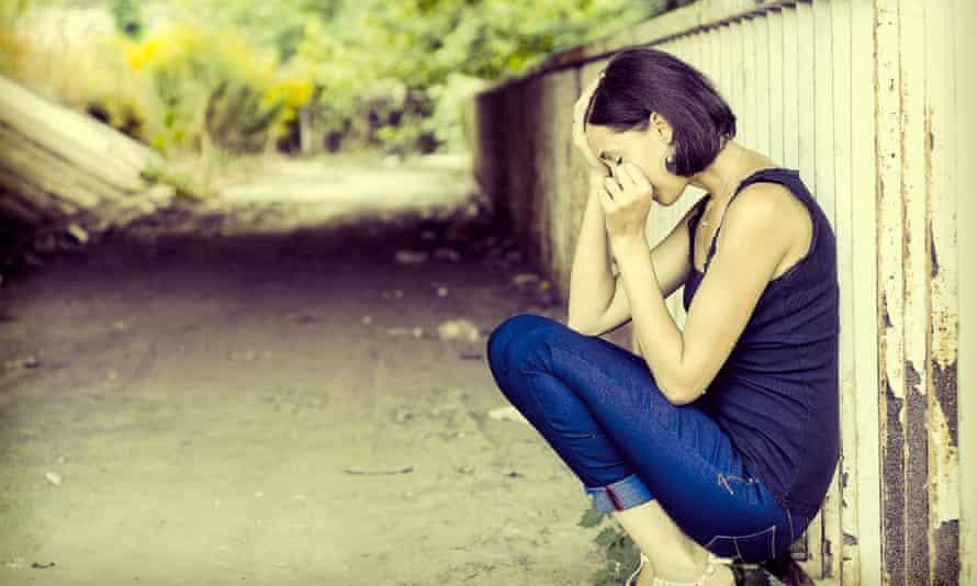 Sad woman in the street