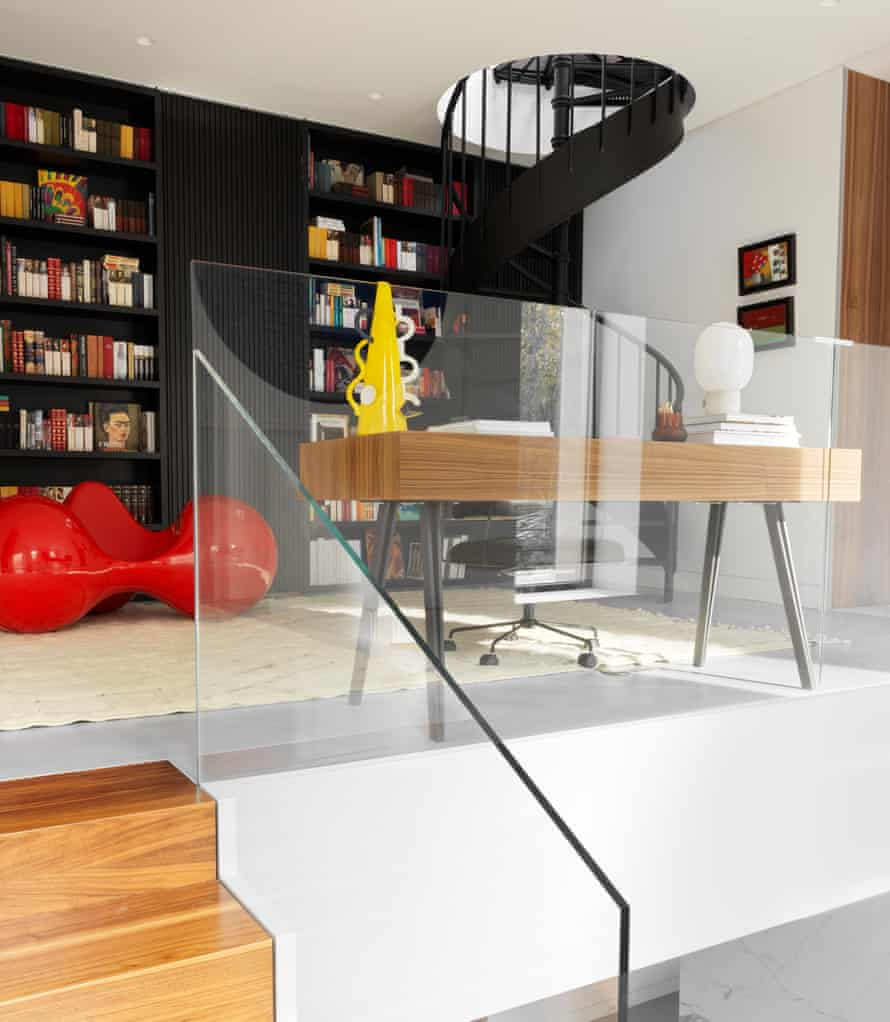 The surprisingly peaceful landing-hallway office and studio space, and the spiral staircase leading to a toy-filled attic