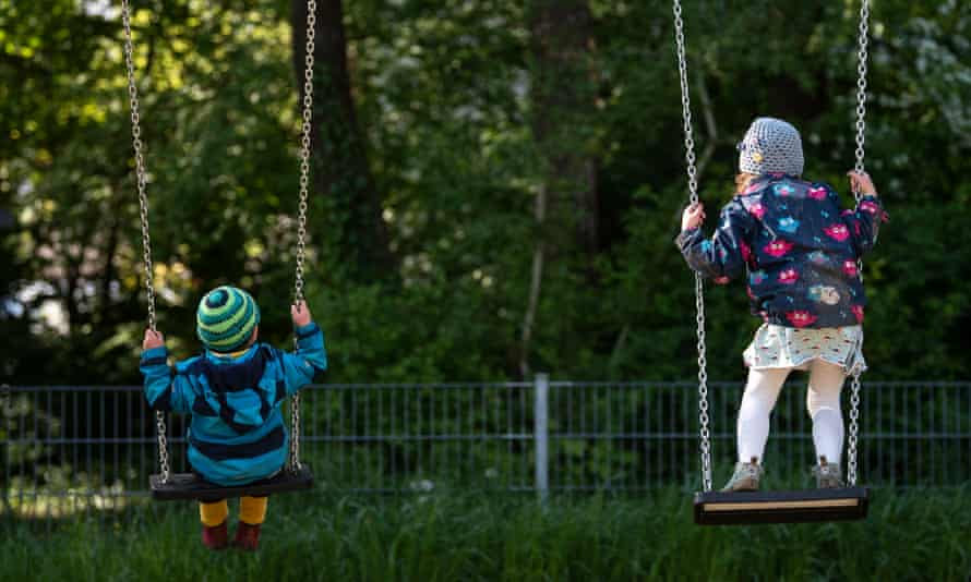 Children at a playground in Munich, Germany, where playgrounds have opened again.