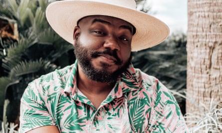 Kelvin Davis in a Hawaiian shirt and straw boater