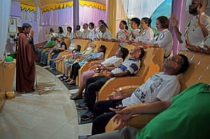 Devotees receive spiritual healing for their medical ailments at a ceremony at their temple complex