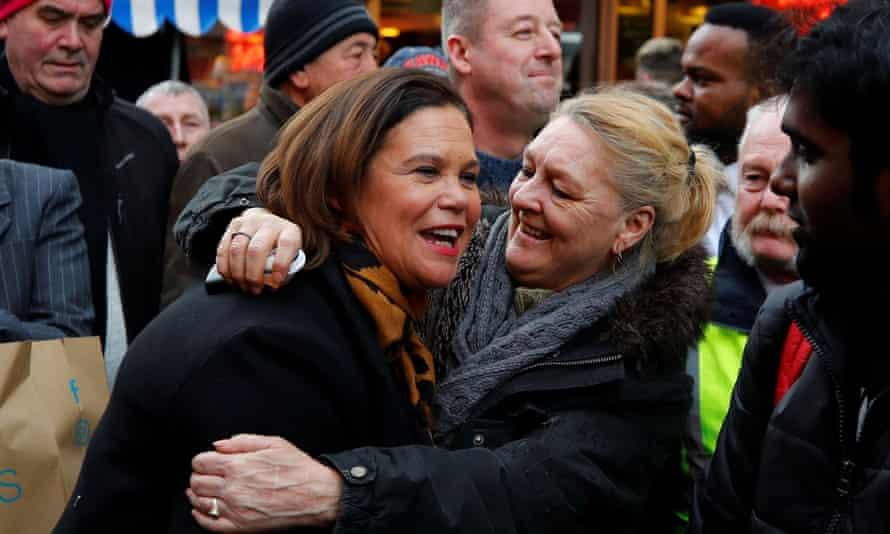 A voter hugs Mary Lou McDonald