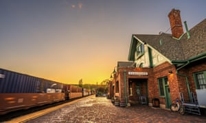 Train going through the station in Flagstaff at sunset, Arizona, US.