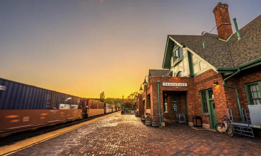 Amtrak Train going through the historic train station in Flagstaff at sunset.