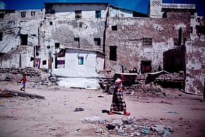 A man walks passed some old houses near the port in in the Somali capital Mogadishu