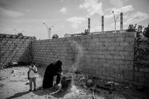 Alwan, 39, cooks breakfast for her family