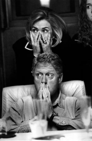The Clintons listen to a midair briefing in 1996.