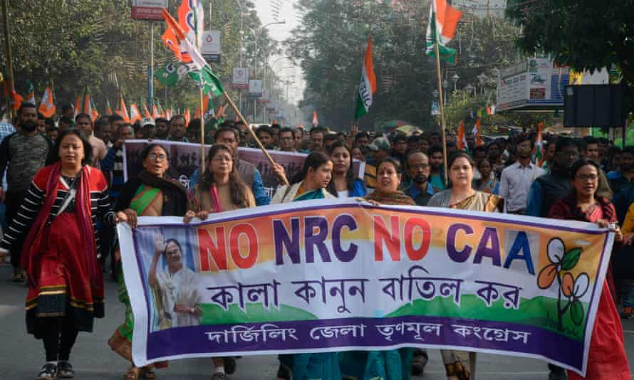 Protesters take part in a rally against India's new citizenship law in the Indian state of West Bengal on Monday.