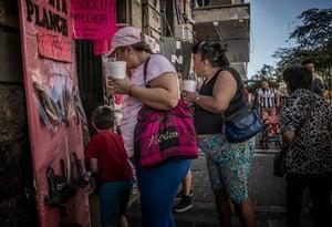 Women carrying large sugary drinks shop in central Guadalajara