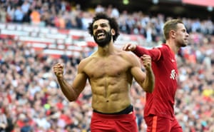 Mohamed Salah celebrates by stripping off.